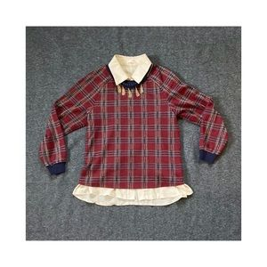 A red and blue plaid pullover sweater